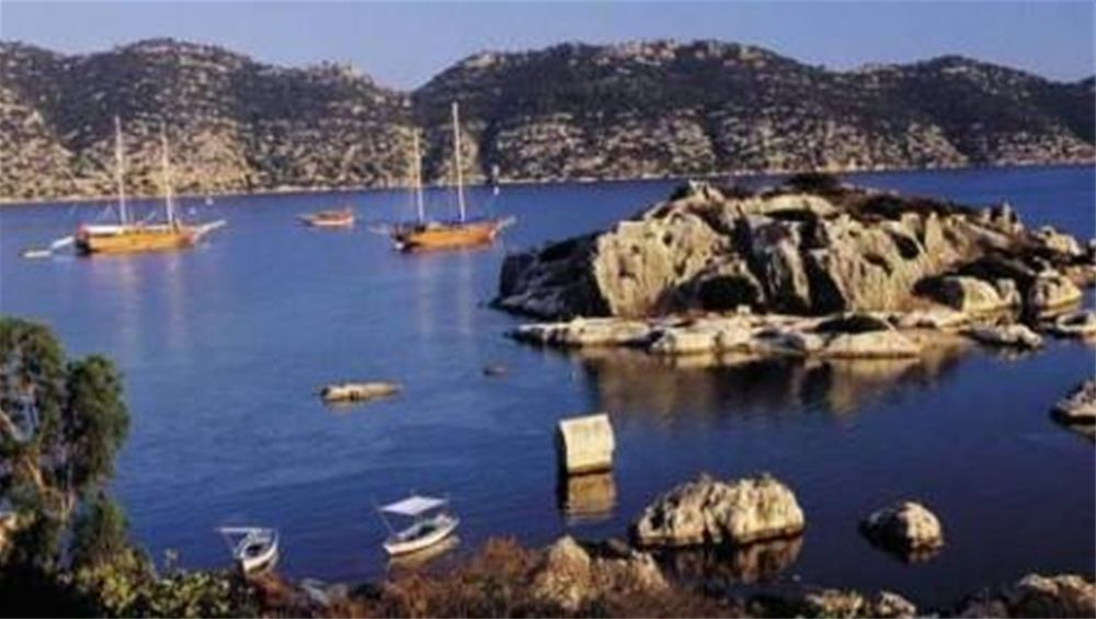 Charter Yachts at anchor in Kekova, Turkey - visit by chartering a Crewed or Bareboat yacht from Gocek with OceanBLUE